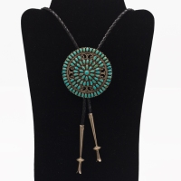 Our silversmiths created this stunning bolo tie from a Larry Moses Begay pin!