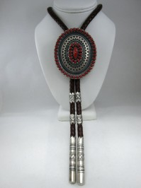This was originally an Ernest Roy Begay buckle which was converted to a bolo tie with custom tips and ferrules