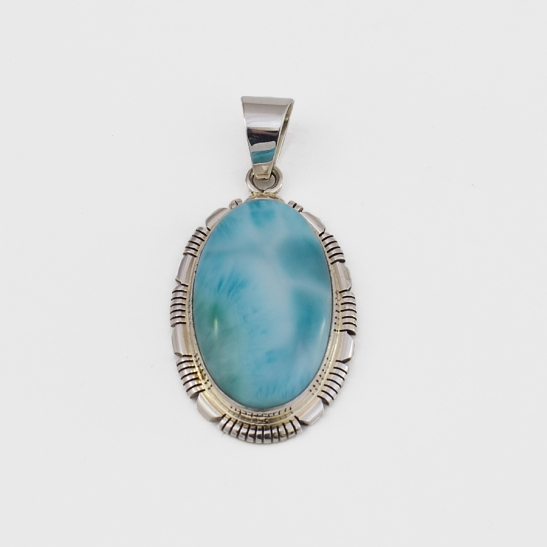 A silver and larimar pendent
