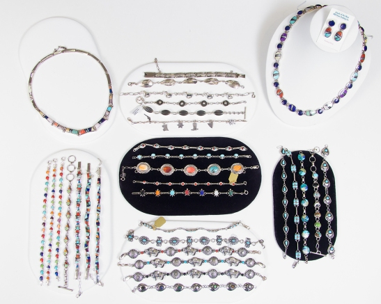 Bracelets and necklaces from the jewelry cases on the floor