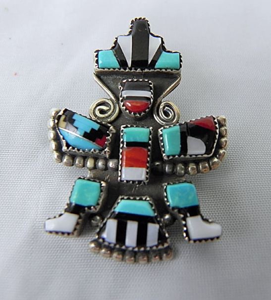 This photo was sent to us by a customer. Can you spot the problem? Hint: It's on the left side! A repair was made to this Zuni pendent by an unknown source. The lost stones were replaced with colored plastic. This is one of those that leaves us shaking our heads!
